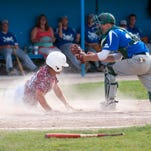 Jimmy Jackson of Behnke's beats the Scorpions' Kody Moore to the bag at first base.