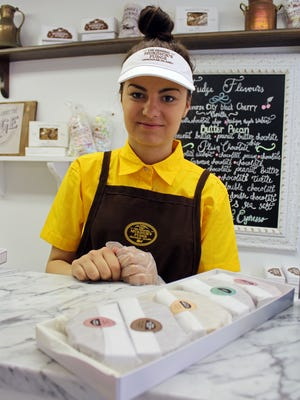 Moya Petricevic of Bosnia sells fudge by the half-pound slice at Murdick's on Mackinac Island.