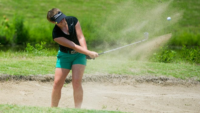 Katelyn Skinner hits out of the bunker onto the eighth green during the final round of the Women's City golf tournament at Cambridge golf course on Sunday, July 1, 2018.