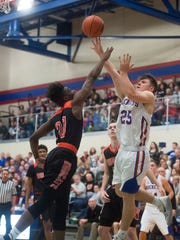 Spring Grove's Jonathan Sager shoots over Northeastern's
