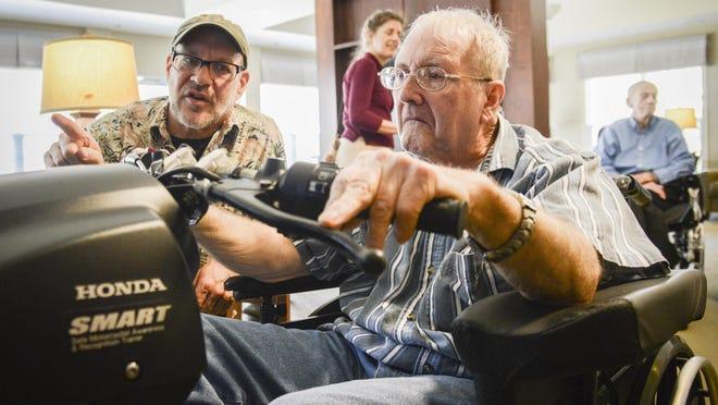 Garry Segal guides veteran Gary Hedrick on a motorcycle simulator at N.C. State Veterans Nursing Home in Black Mountain