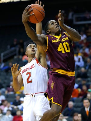 Arizona State guard Shaquielle McKissic drives past Maryland guard Melo Trimble in the second half of a CBE Hall of Fame Classic game on Monday, Nov. 24, 2014, in Kansas City, Mo.