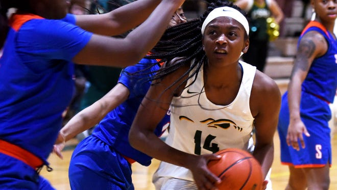 Captain Shreve's Kennedi Heard led the Lady Gators to a second consecutive District 1-5A title.