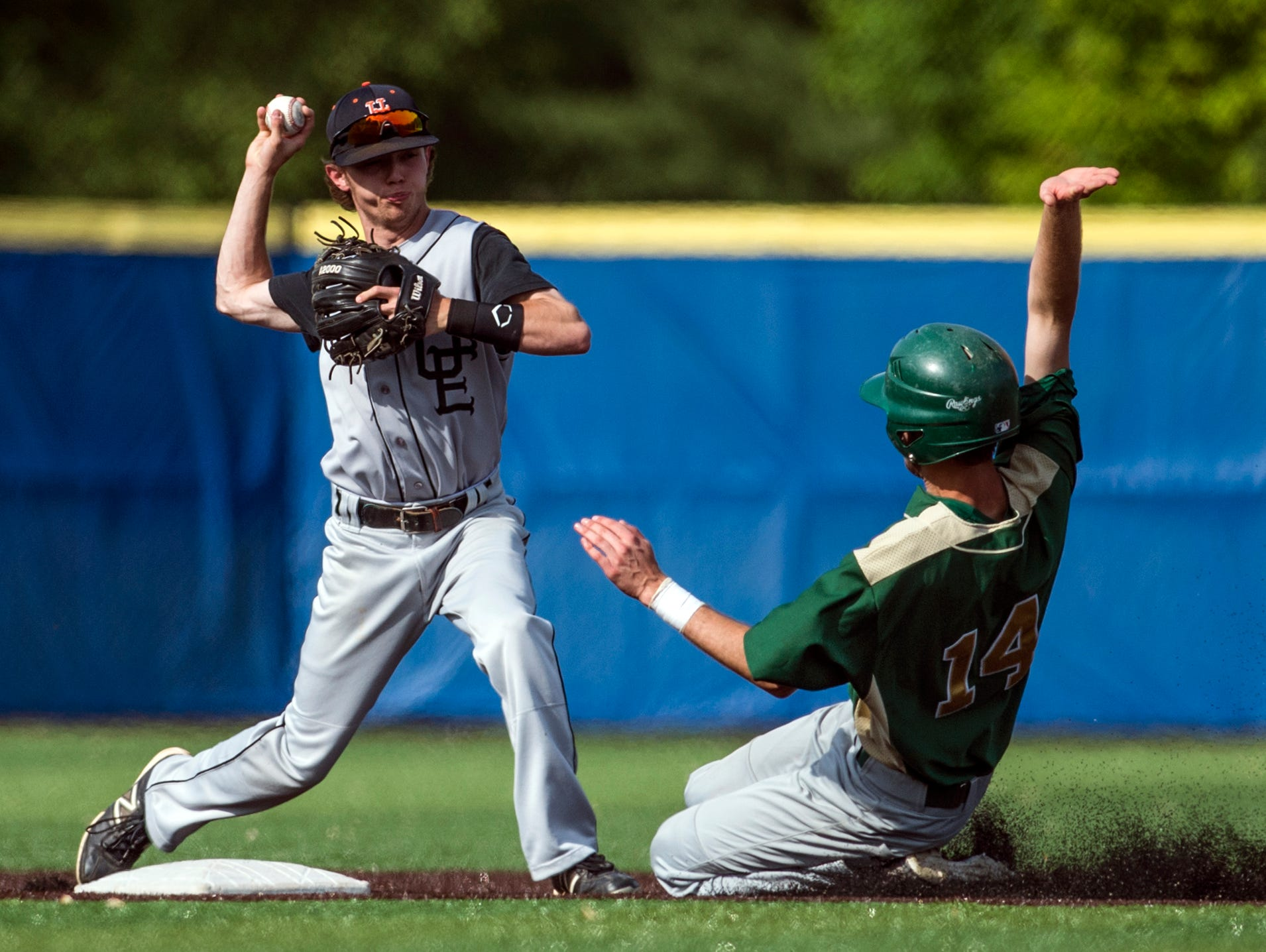 Union-Endicott's second baseman Mark Ryan turns a double play in the bottom of the second inning of the Section 4 Class A title game against Vestal on Friday at Maine-Endwell High School. Union-Endicott won 4-1.
