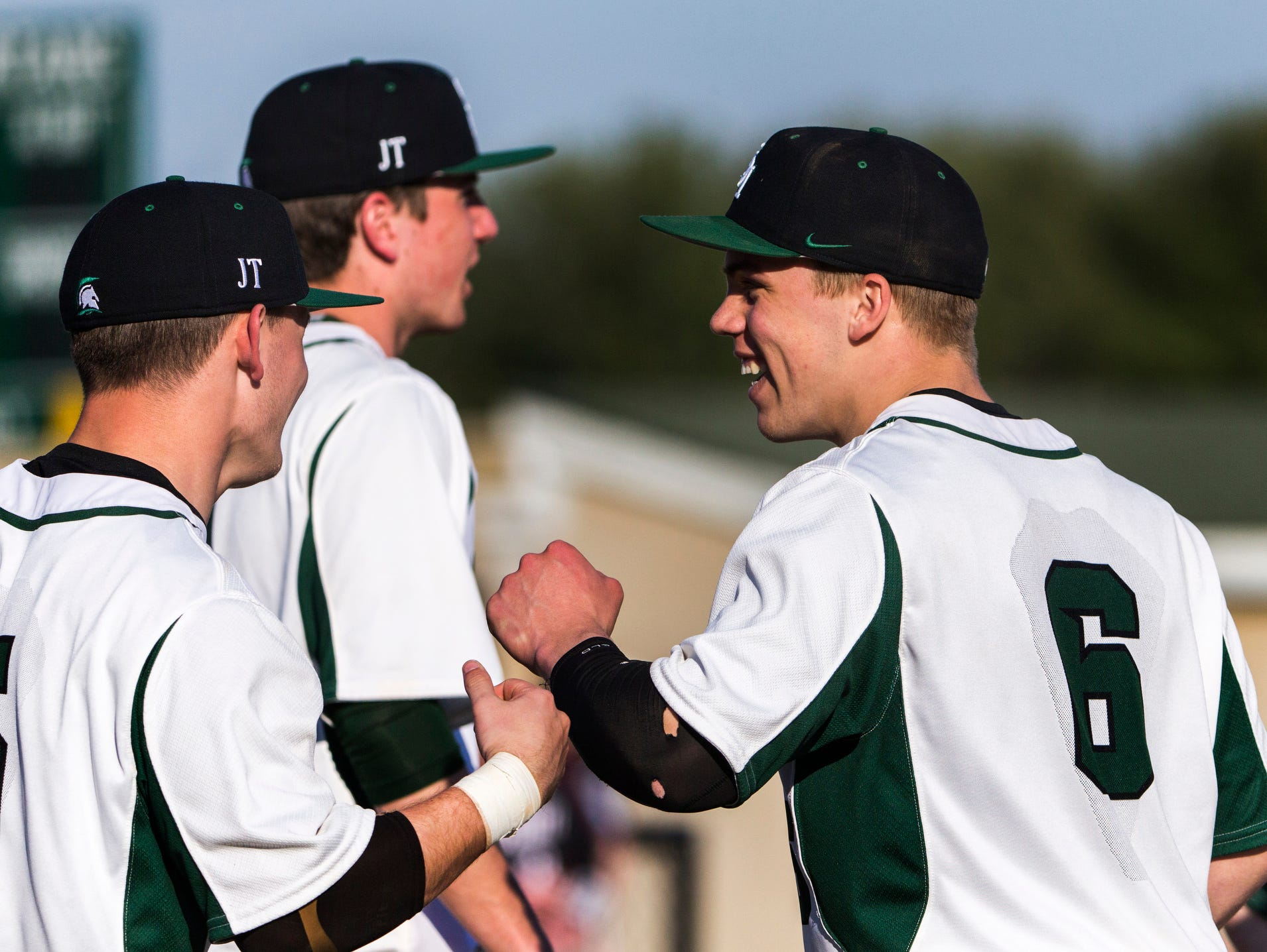 St. Mark's pitcher Andrew Reich (No. 6) celebrates with teammates after throwing a no-hitter in St. Mark's 12-0 win over Hodgson at St. Mark's High School on Wednesday afternoon.