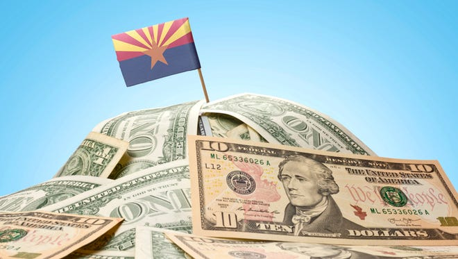 The flag of Arizona sticking in a pile of American money.