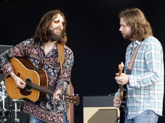 Chris Robinson, left, and Rich Robinson perform with the Black Crowes at the Newport Folk Festival at Fort Adams State Park in Newport, Rhode Island in 2008.