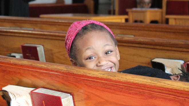 Belleville's Abigail Theodore, 5, during a presentation on black history the Second Baptist Church on Stephens Street in Belleville.