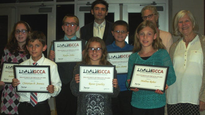 Front row, from left, are: Award winners Christian P. Arentz, violin, choir and guitar, Franklin Township Elementary; Reese Gourley, cello, Lincoln Elementary; Malina Reber, viola and choir, James Gettys Elementary; back row: Aubrey Woltz, trumpet and choir, Bendersville Elementary; Keefer Stiles, percussion, St. Francis Xavier and Raiden Shomo, violin, Conewago Valley Intermediate; posing with Vassily Primakov; and awardees board member Sara Rohr and GCCA Outreach Award Chairperson, Barbara Stokes. Lily Herren, choir/soprano, Gettysburg Montessori Charter School is missing from the photo.
