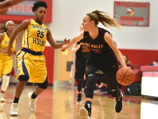 McAuley's Hallie Heidemann searches for a teammate