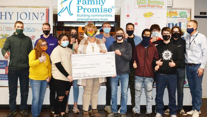 The morning BACC business students presenting their donation to Terri Huffman, director of Family Promise.
