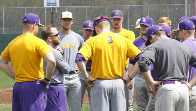 Elmira College head coach Corey Paluga, second from left, talks to his team during a recent practice at Dunn Field.