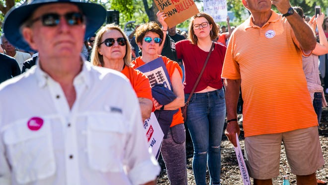 Protestors rally in Cambier Park in downtown Naples on Saturday, March 24, 2018 in solidarity with the national March For Our Lives in Washington D.C.. A group of students from Marjory Stoneman Douglas High School organized the national protest after 17 people were killed at their school in February.
