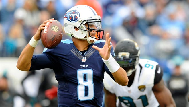 Dec 6, 2015; Nashville, TN, USA; Tennessee Titans quarterback Marcus Mariota (8) attempts a pass during the first half against the Jacksonville Jaguars at Nissan Stadium. Mandatory Credit: Christopher Hanewinckel-USA TODAY Sports