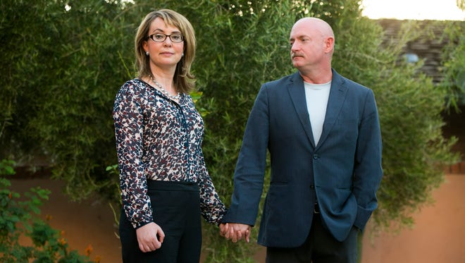Former congresswoman Gabrielle Giffords and her husband, Mark Kelly, a former NASA astronaut, at their home in Tucson on Sept. 23, 2014.