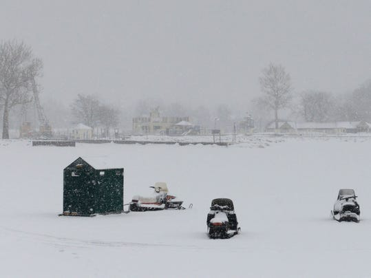 Ice fishermen try their luck on lake erie for Port clinton fishing report