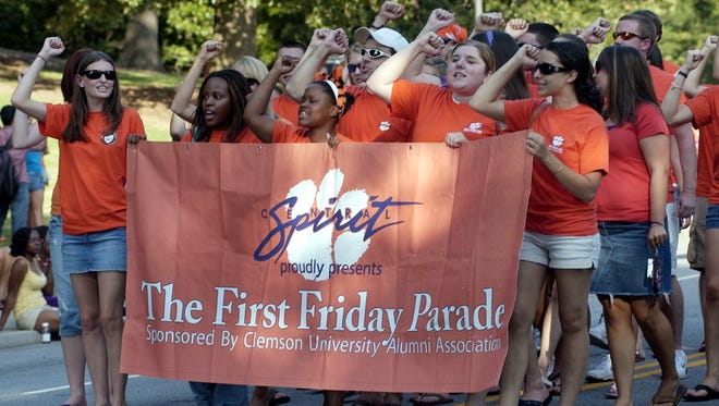 A file photo shows students walking in Clemson University's annual First Friday parade in 2008.