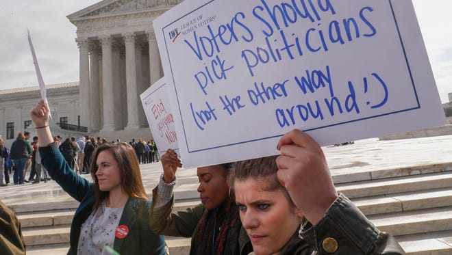 Protesters demonstrated outside the Supreme Court in March when the justices heard the second of two cases challenging the way state legislatures draw election maps to favor the party in power.