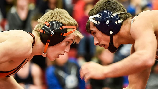 North Union's Trace Rasey, left, and River Valley's Devin Hessler square off at the MOAC Wrestling Championships earlier this season at 145 pounds. Both wrestlers won sectional championships over the weekend
