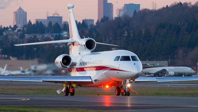 A Falcon 7X business jet taxies for take-off at Seattle's Boeing Field in this 2013 file photo.