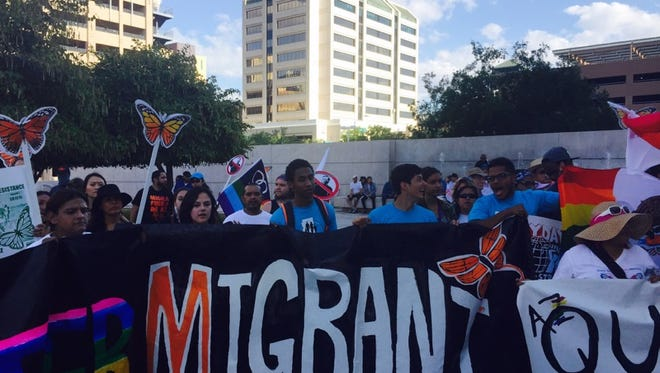 Protesters mark through downtown Phoenix on April 23, 2015 to commemorate the fifth anniversary of SB 1070.