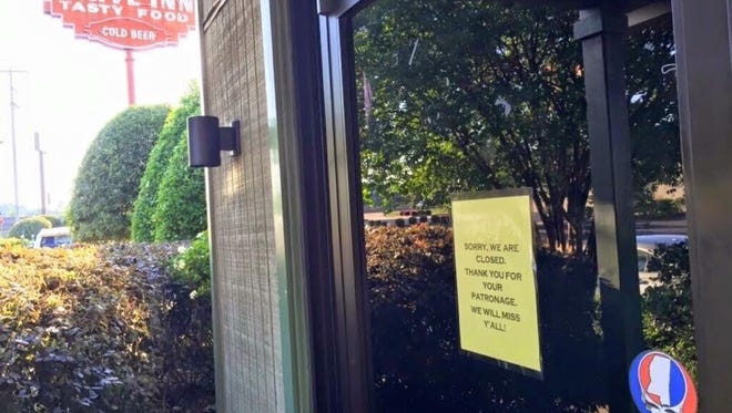 A sign on the Cherokee Inn's door suggests the landmark restaurant and bar has closed.