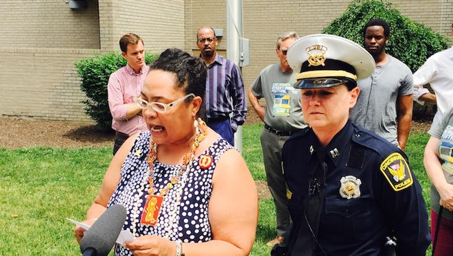 Kathryne Gardette (left), a member of the  Walnut Hills Area Council, speaks at a news conference Friday, clarifying comments made by Cincinnati Police District 4 Capt. Maris Herold, right. Both said the comment was taken out of context.