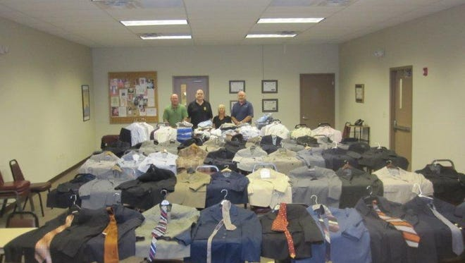 Consider donating some of your gently-used, work-appropriate clothing to the Louisiana Department of Public Safety and Corrections to help men and women who are leaving state correctional facilities. (From left) Clay Marcantel, Michael Wynne, Tammy Bordelon and David Gauthier stand before some of the clothing donated in Alexandria so far.