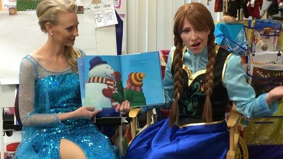 Jamie Scott, left, and Katie Whited read to children in Mrs. Decker's class at Riverside Elementary.