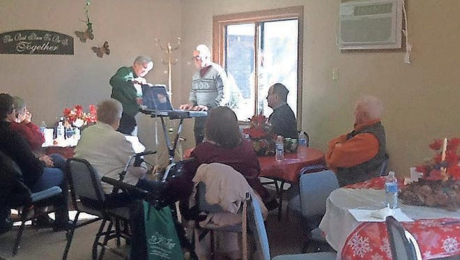 Live music was provided for this Christmas party at Town and Country Apartments in Williamsburg Saturday, Dec. 19.