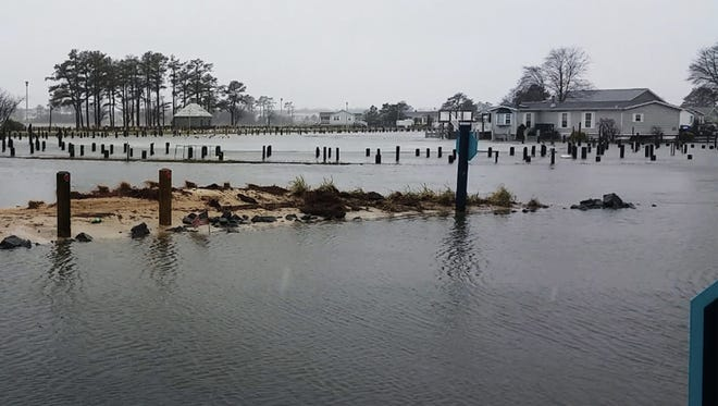 Bayfront properties see significant floods in Long Neck, Delaware on Saturday, Jan. 23.