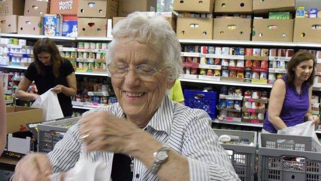 "Evelyn ""Tudy"" McMurray, 91, is one of Fondy Food Pantry's dedicated volunteers."