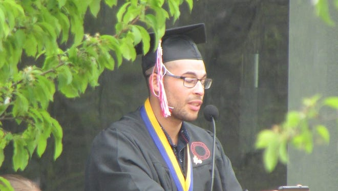 Alan Smith addresses fellow graduates during the Corning Community College's 57th Commencement.