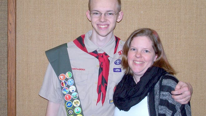 New Eagle Scout Ryan Poertner, left, stands with his mother, Jessica Flores.