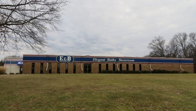 The facility formerly owned by E&B Distributors is becoming the corporate headquarters for Open Road Auto Group.