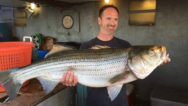 Nate Boll, Pennsburg, Pennsylvania, with the pool winning 40-pound striped bass he caught on the 125-foot Jamaica on June 12.