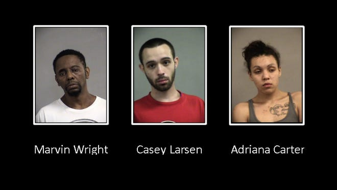 Three people were arrested after shots were fired at officers while they serving a warrant as part of a narcotics investigation.