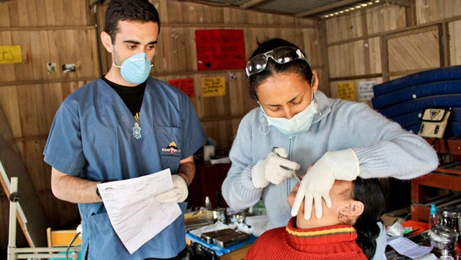 FSU MEDLIFE members treat Lima locals during their summer trip.
