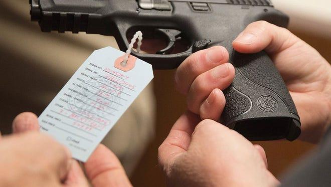 Customers shop for a handgun at Metro Shooting Supplies in Bridgeton, Missouri.