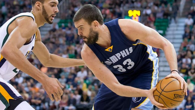 Nov 14, 2016; Utah Jazz center Rudy Gobert (27) defends against Memphis Grizzlies center Marc Gasol (33) during the first half at Vivint Smart Home Arena.
