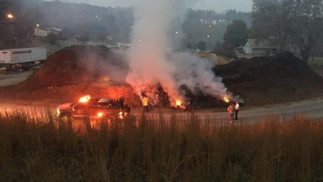 A Sunday morning mulch pile fire near Biltmore Lake has residents upset.
