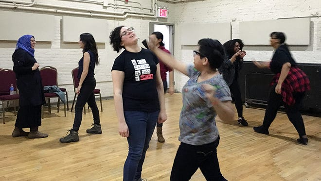 Women participate in a self-defense class at the Muslim Community Network in New York on Dec. 3, 2016.
