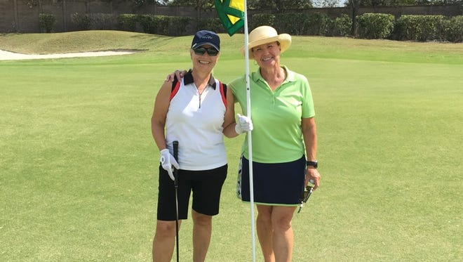 RosAnne Atkins, left, and Judy Yanachik each made a hole-in-one on No. 7 on the Whispering Oaks Course at Verandah Club in Fort Myers, Fla., on Tuesday, Feb. 28, 2017.