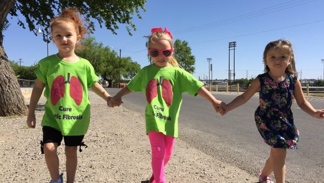 Zoey Spinks, 4, center, was diagnosed with cystic fibrosis when she was 16 days old. She enjoys the company of her friends Chloie McCoy and Ella Musshorn at last year's Great Strides 5K Walk for Cystic Fibrosis.