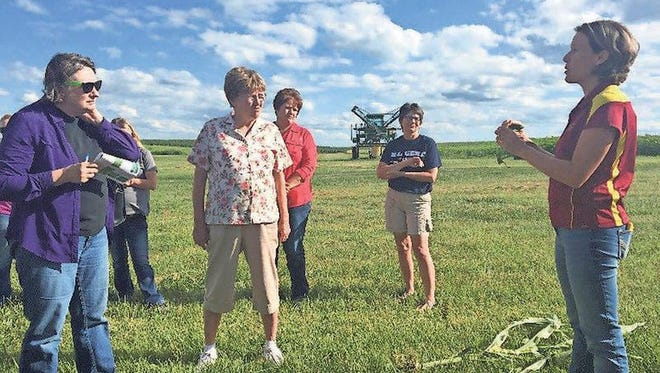 Dr. Alison Robertson, ISU Extension Plant Pathologist, sharing how to ID common corn diseases with the Washington County cohort in July 2016.