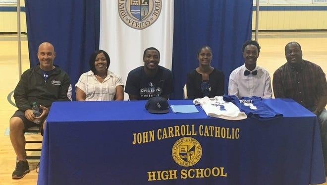 JCHS Head Football Coach Chris Hutchings, Chris Polk, Jamal Polk (JCHS Student), Maria Miller, U.J. Miller (JCHS Student), and Umah Miller