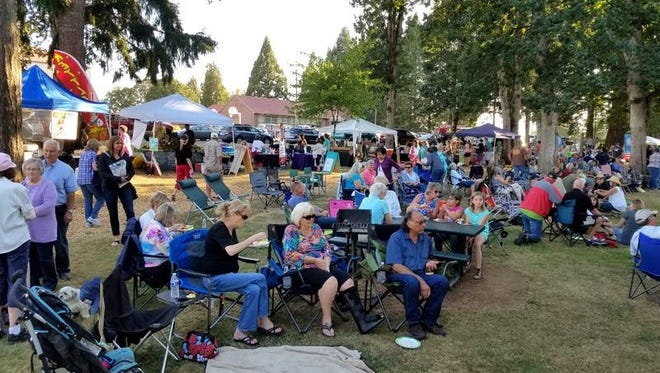 Friends and neighbors enjoy the Sublimity First Tuesday celebration at Church Park.
