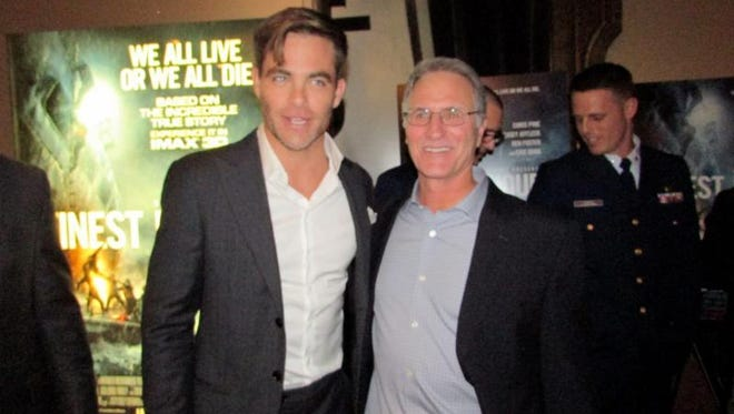 "Actor Chris Pine (left) star of the Disney movie ""The Finest Hours,"" poses with Michael J. Tougias, a co-author of the book."