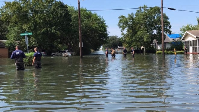 Coast Guardsmen completed house to house searches in neighborhoods near Houston, Texas.