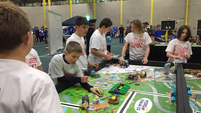 Owen Auxter, Parker Fanning, Cameron Gillum, Gavin Malloy, Akella Nardecchia, and Jordan Mazur prepare for the game table portion of the LEGO  League competition.
